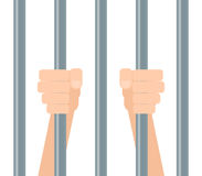 Hands behind bars Stock Image
