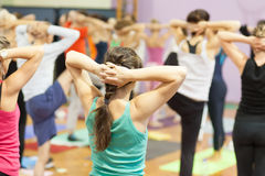 Hands behind head at yoga class Royalty Free Stock Image