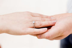 Hands with betrothal ring. Hands of young couple with betrothal ring Stock Images