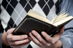 Hands and bible. Man is holding open bible stock photography