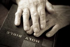 Hands on the  bible Royalty Free Stock Images