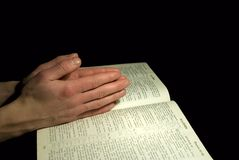 Hands on Bible Royalty Free Stock Image