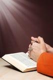 Hands an Bible praying Stock Photos