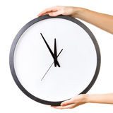 Hands with a big clock. Woman holding a big clock isolated on a white background. Time concept Stock Image