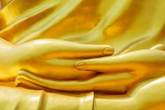Hands Big Golden Buddha statue in Thailand temple stock photography