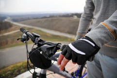 Hands on a bike handlebar Stock Photo