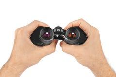 Hands with binoculars Stock Photo