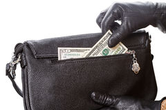 Hands in black gloves and dollars Royalty Free Stock Photography