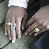 The hands of a black man with rings Royalty Free Stock Images