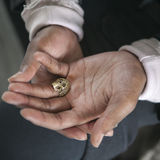 The hands of a black man with rings Stock Photo