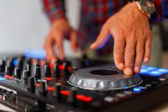 Hands with audio control. Mixing tracks. Professional Controlle. Hands with black modern audio control. Mixing tracks. Professional Controller royalty free stock image