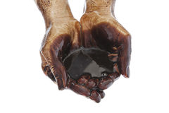 Hands with black oil on white Stock Images