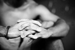 Hands. Black and white photo of rock climber's hands, fingers intertwined, with chalk on them Royalty Free Stock Images