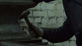 The Hands Of A Blacksmith Man Are Hammering An Iron Piece stock video footage