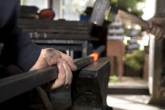 Hands of blacksmith by the work Royalty Free Stock Image