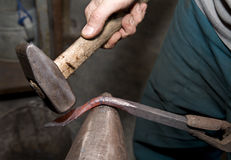 Hands of blacksmith by the work Royalty Free Stock Photo