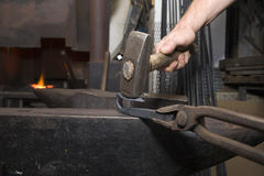 Hands of blacksmith by the work Stock Photos