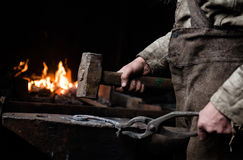The hands of a blacksmith at work in the smithy Stock Images