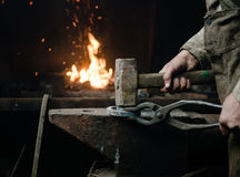 The hands of a blacksmith at work in the smithy Royalty Free Stock Image