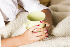 Hands on blanket with coffee Stock Images