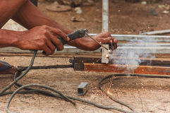 Hands and blowtorch Royalty Free Stock Photography