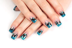 Hands with blue manicure. Nail Stock Image