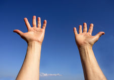 Hands on blue sky. Open hands on blue sky royalty free stock images