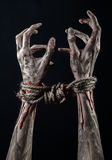 Hands bound,bloody hands, mud, rope, on a black background, isolated, kidnapping, zombie, demon. Hands bound,bloody hands, mud, rope, on a black background Royalty Free Stock Photos