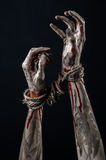 Hands bound,bloody hands, mud, rope, on a black background, isolated, kidnapping, zombie, demon. Hands bound,bloody hands, mud, rope, on a black background Royalty Free Stock Photo