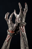 Hands bound,bloody hands, mud, rope, on a black background, isolated, kidnapping, zombie, demon Stock Photo
