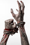 Hands bound,bloody hands, mud, rope, on a white background, isolated, kidnapping, zombie, demon. Hands bound,bloody hands, mud, rope, on a white background Stock Images