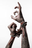Hands bound,bloody hands, mud, rope, on a white background, isolated, kidnapping, zombie, demon Stock Images
