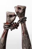 Hands bound,bloody hands, mud, rope, on a white background, isolated, kidnapping, zombie, demon Royalty Free Stock Images
