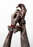 Hands bound,bloody hands, mud, rope, on a white background, isolated, kidnapping, zombie, demon. Hands bound,bloody hands, mud, rope, on a white background Stock Photos