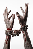 Hands bound,bloody hands, mud, rope, on a white background, isolated, kidnapping, zombie, demon Stock Photos
