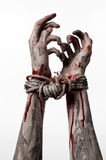 Hands bound,bloody hands, mud, rope, on a white background, isolated, kidnapping, zombie, demon Stock Photography