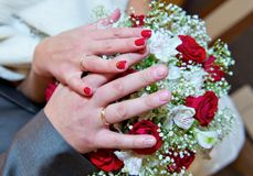 Hands on a bouquet Stock Images