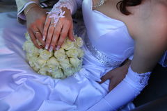 Hands on a bouquet Stock Photo
