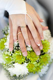 The hands on the bouquet Suite. Royalty Free Stock Photos