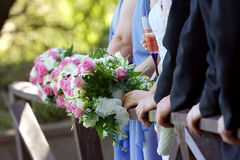 Hands and bouquets. Stock Photo