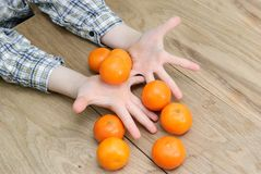 Hands of a boy with oranges Royalty Free Stock Photo