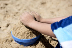 Hands boy playing. With sand Royalty Free Stock Image