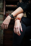 Hands with bracelets Royalty Free Stock Photos