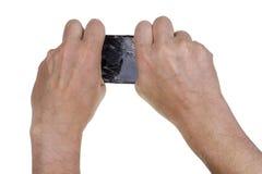 Hands break and twist  broken phone Stock Image