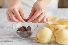 Hands breaking a chocolate in bowl Royalty Free Stock Photos
