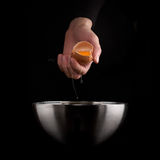 Hands breaking an egg. Royalty Free Stock Images