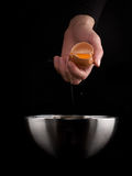 Hands breaking an egg. Stock Images