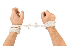 Hands and breaking rope Royalty Free Stock Photography
