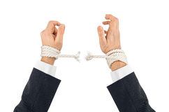 Hands and breaking rope Stock Photos
