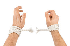 Hands and breaking rope Stock Photo